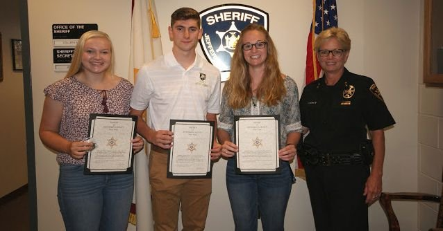 """Pictured (l to r) Amanda Lloyd, Nathan Tyler, Elizabeth """"Libby"""" Connors and Sheriff Colleen O'Neill."""