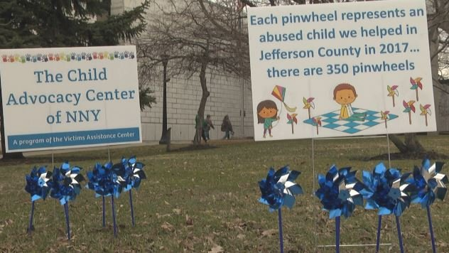 Blue pinwheels give voice to children who have died from abuse
